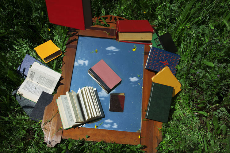 High angle view of open book on field