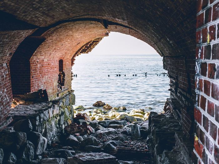 Ruins of the Western Fort. Pillau. Travel Destinations Scenics - Nature Horizon Over Water Outdoors Building Exterior Beauty In Nature Land Beach Building Day Sky No People Nature Sea Arch Built Structure Architecture Water Cave Geological Formation Rock Stone Travel Fortress Landscape Ocean Coast Cliff Tourism Vault Solid Rock - Object Wall Bridge EyeEmNewHere