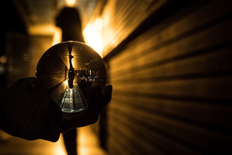 Close-up of hand holding illuminated lamp