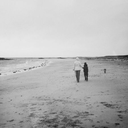 Beach Copy Space Day Dog Walking Dull Mother And Son Outer Hebrides Rainy Day Rear View Remote Sand Scotland Sea Shore Solitude Togetherness Walking Walking The Dog