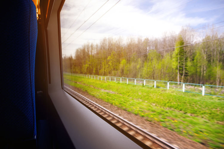 Train Window View Landscape Travel Motion Blurred Journey Transport Summer Abstract SPAIN Green Background Looking Railway Railroad Blur Out Rail Vacation Transportation Nature Speed Sky Passenger Trip Tourism Tree Russia Moscow Petersburg Blue Outdoor Land Vehicle Interior Mode Of Transportation Rail Transportation Plant Glass - Material Grass Train - Vehicle No People Land Vehicle Public Transportation Transparent Environment Day Outdoors Track