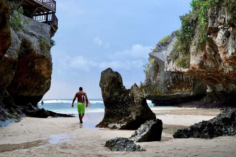 Bali Surf Surfer Beach Beauty In Nature Cliff Day Full Length Holiday Land Leisure Activity Lifestyles Looking At View Nature One Person Outdoors Real People Rock Rock - Object Rock Formation Scenics - Nature Sea Sky Solid Water The Great Outdoors - 2018 EyeEm Awards The Traveler - 2018 EyeEm Awards The Portraitist - 2018 EyeEm Awards Capture Tomorrow