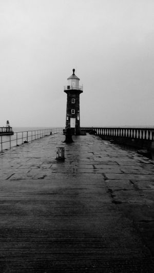 The Week On EyeEm Harbour View Whitby North Yorkshire Whitby Harbour Safety Lighthouse Sea Protection Beach Security Horizon Over Water Built Structure Water Building Exterior Architecture Sand Lifeguard  Lifeguard Hut Outdoors Tranquility No People Sky Scenics Day