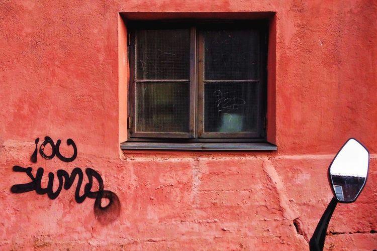 Red window on brick wall