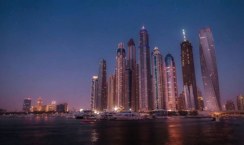 Panoramic view of city buildings at night