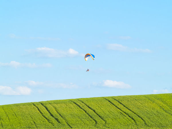 Adventure Adventure Sports Aereal View Agricultural Land Day Extreme Extreme Sport Extreme Sports Field Flying Flying High Leisure Activity Lifestyles Man Mid-air Nature One Person Outdoors Parachute Paraglider Paragliding People Real People Sky Sport Art Is Everywhere Go Higher