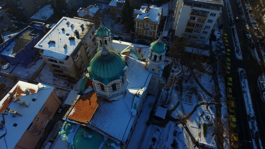 High angle view of church and buildings in city