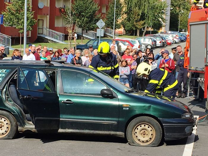Large Group Of People Men Women Real People Spectator People Day Sitting Outdoors Crowd Adults Only Adult Firefighter In Work Car Crash