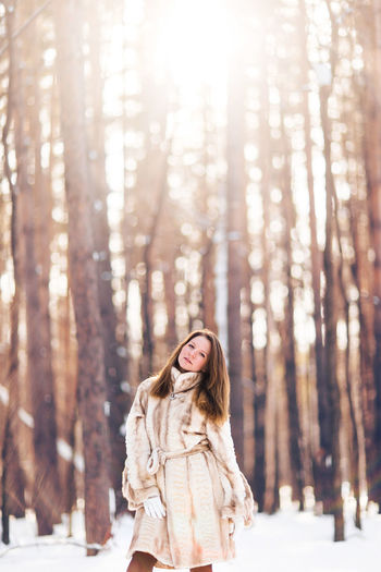 Woman in forest during winter