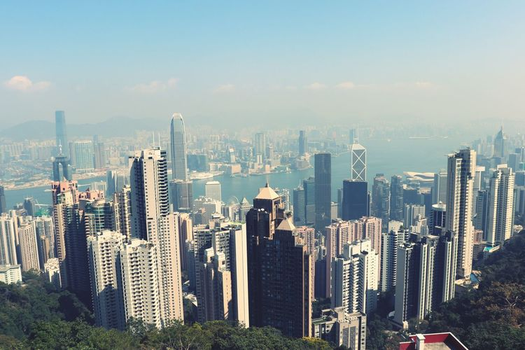 Panoramic view of modern buildings in city against sky