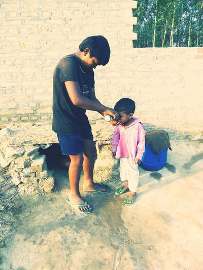 SumitAssaniaphotography Childhood Unconditional Love Helping Hand Kids Water haryana village Save Water beauty of villages Summer Summertime Big Brother Life Is Beautiful Jind Haryana Coolpadnote3litephotography Puñay Two Kids