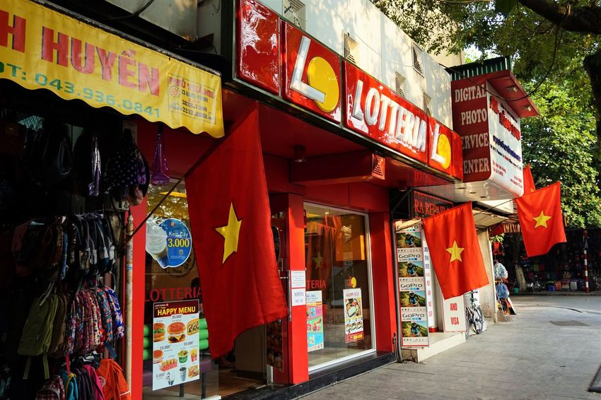 Architecture Day Flags Hanoi Minimart No People Non-western Script Outdoors Red Streetphotography Text Tourism Travel Vietnam Vietnam Flag