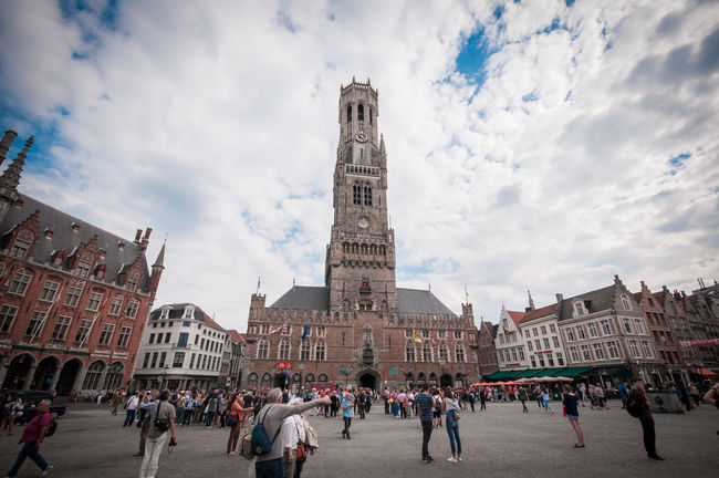 Architecture Belfort Building Exterior Built Structure Church City Life Clock Tower Composition Culture Famous Place Fish-eye Lens History International Landmark Low Angle View Outdoors Perspective Place Of Worship Religion Spirituality Tourism Tower
