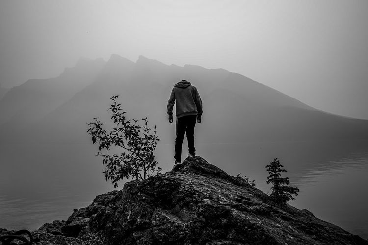 I'm the king of the hill Blackandwhite Monochrome Mountain Full Length Men Adventure Lake Hiking Standing Backpack Silhouette Discovery Physical Geography Rock Formation Rocky Mountains Canyon Geology Natural Landmark Wonderlust Rock - Object Rock