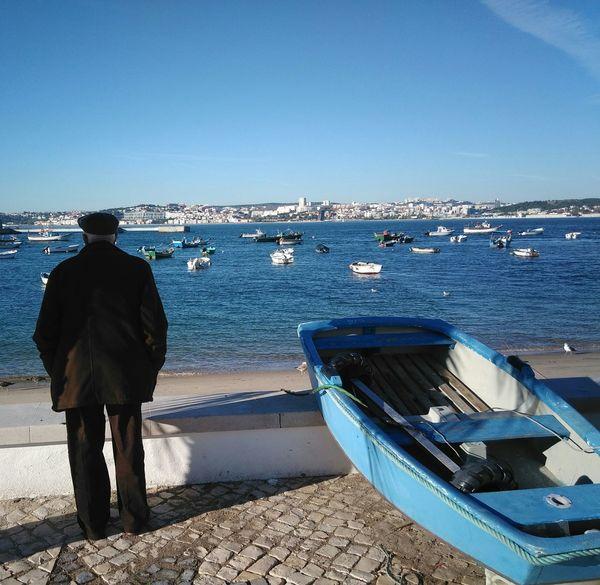 Man Looking At Sea Boat Boat Shore Horizon Over Water Calm Ocean Port Dock