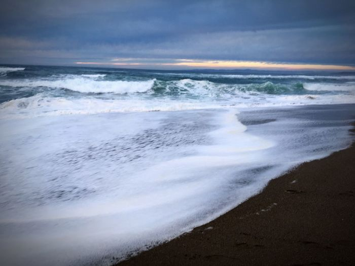 Sea Wave Beach Surf Water Nature Shore Beauty In Nature Motion Sky Power In Nature Horizon Over Water Outdoors Scenics No People Day Cloudy Sunset
