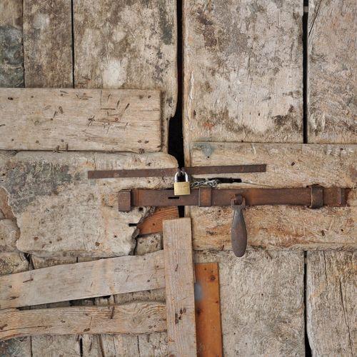 Close-Up Of Locked Old Wooden Door