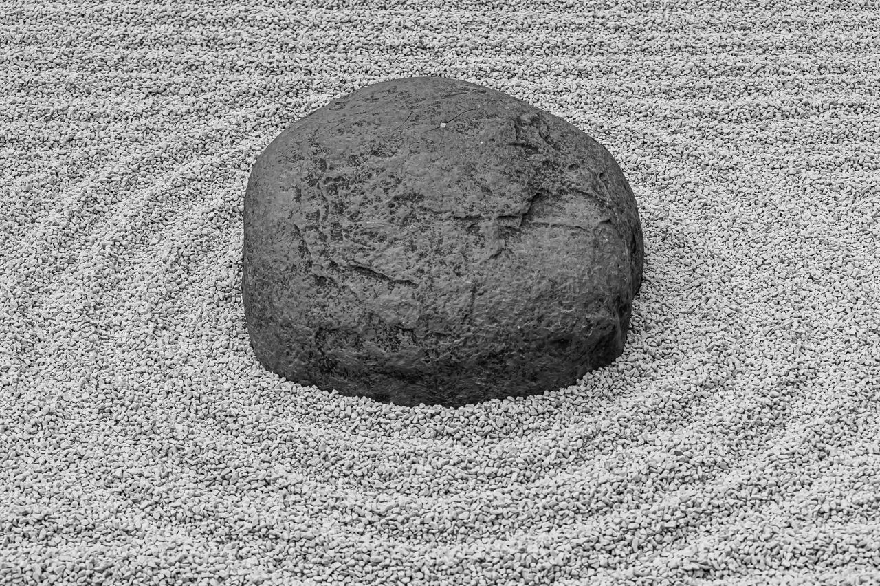 no people, solid, close-up, textured, rock, circle, geometric shape, shape, nature, stone - object, high angle view, land, stone, rock - object, pattern, outdoors, day, single object, design, stone material, pebble