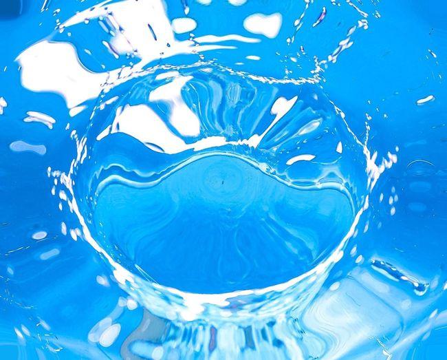 Full frame shot of blue water splashing