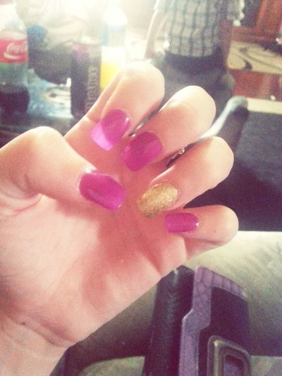 Gold and purple nails. .