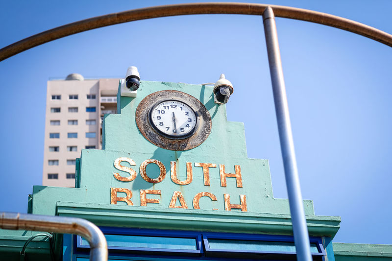 South Beach South Beach Sky Clear Sky Day Blue No People Text Clock Outdoors Built Structure Beach Low Angle View Architecture Number Time Seaside South Africa Rusty
