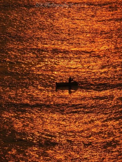 Sunrise reflections on the sea water at Tenneti park Visakhapatanam. Full Frame No People Water Backgrounds Outdoors Nature Sky Day Fisherman Boat Daily Life Sunset Motion First Eyeem Photo