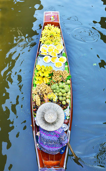 High angle view of person in boat at floating market