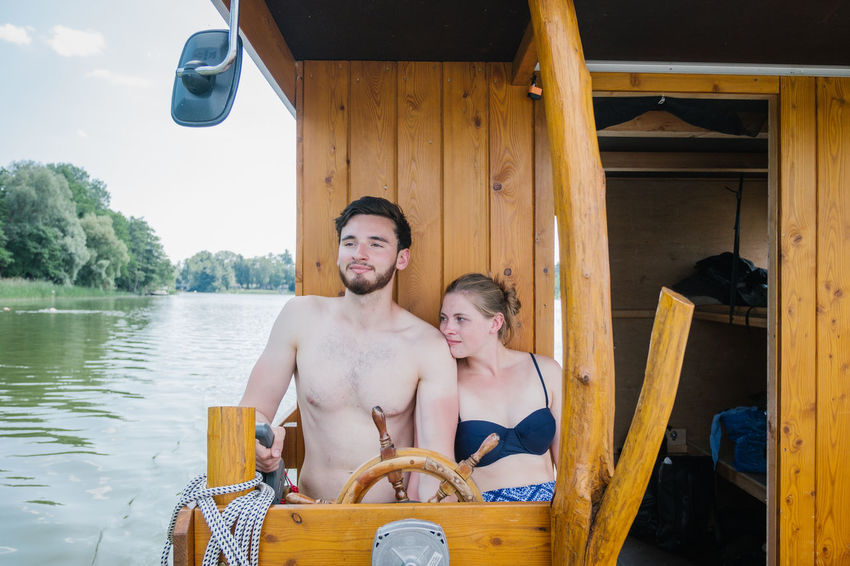 Hausboottour in Lindow / Brandenburg Friends The Great Outdoors - 2018 EyeEm Awards The Portraitist - 2018 EyeEm Awards The Traveler - 2018 EyeEm Awards Youth Boat Boys Couple - Relationship Day Friendship Front View Hausboot Leisure Activity Lifestyles Looking At Camera Males  Men Nature Outdoor Outdoors Portrait Real People Shirtless Sitting Smiling Togetherness Two People Water Wood - Material Young Adult