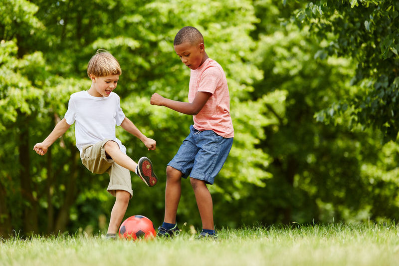 Boys Playing Soccer At Park