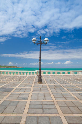 Empty promenade in Santander, spain Empty Places Light Promenade SPAIN Santander Beach Day El Sardinero Lamp No People Nobody Ocean Outdoors Patterns Pavement Scenics Sea Sea And Sky Symmetry Tranquil Scene Tranquility