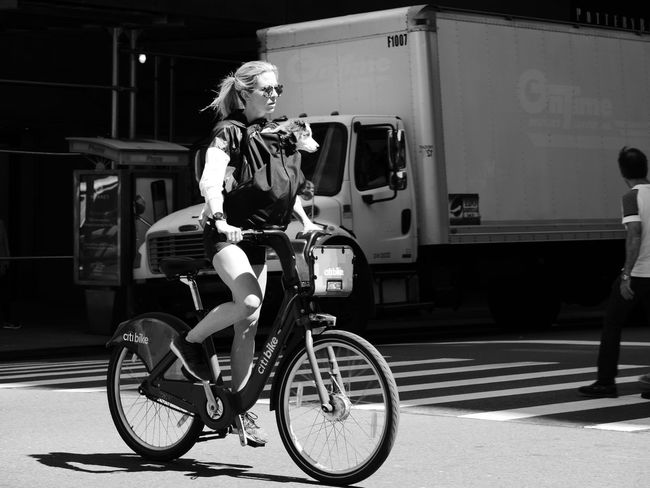 Bicycle Black And White Photography Building Exterior Cycling Helmet Day Full Length Headwear Helmet Land Vehicle Lifestyles Men Mode Of Transport One Person Outdoors People Real People Riding Sports Helmet Standing Transportation Woman And Dog Women