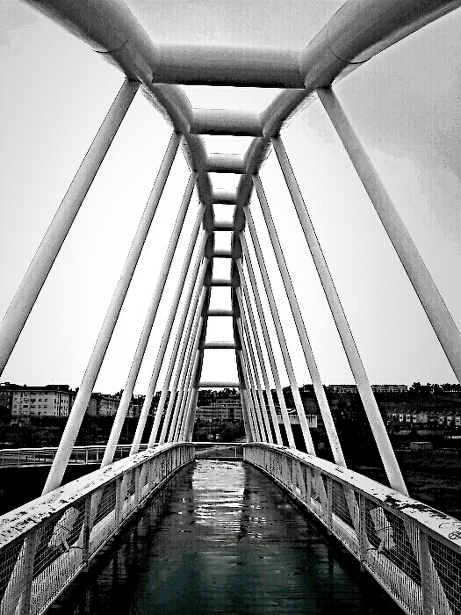 architecture, built structure, bridge - man made structure, water, reflection, low angle view, connection, modern, sky, building exterior, glass - material, indoors, river, diminishing perspective, city, day, bridge, waterfront, engineering, no people