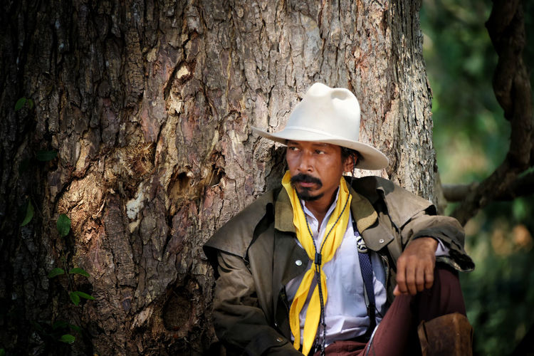 One Person Helmet Tree Portrait Adult Trunk Clothing Tree Trunk Waist Up Hat Headwear Front View Day Nature Plant Mature Adult Men Looking At Camera Outdoors