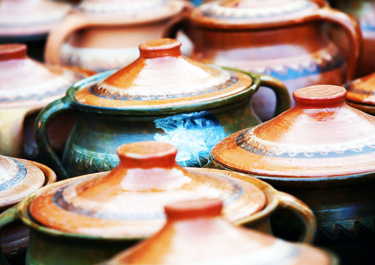 High angle view of romanian traditional ceramic pots for sale at market