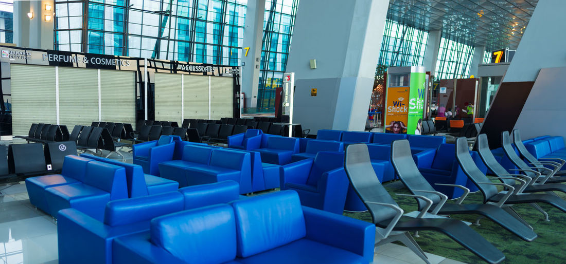 Empty chairs in airport building