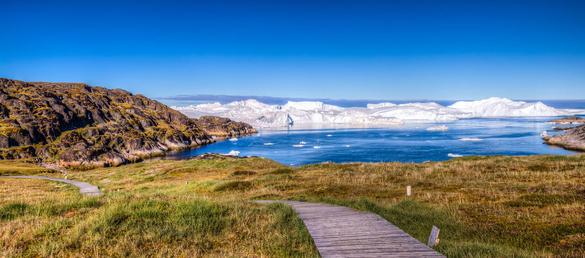 On the way to the Kangia Icefjord Beauty In Nature Day Grass Green Idyllic Ilulissat Landscape Nature No People Non-urban Scene Outdoors Remote Scenics Sky The Way Forward Tranquil Scene Tranquility Water On The Way