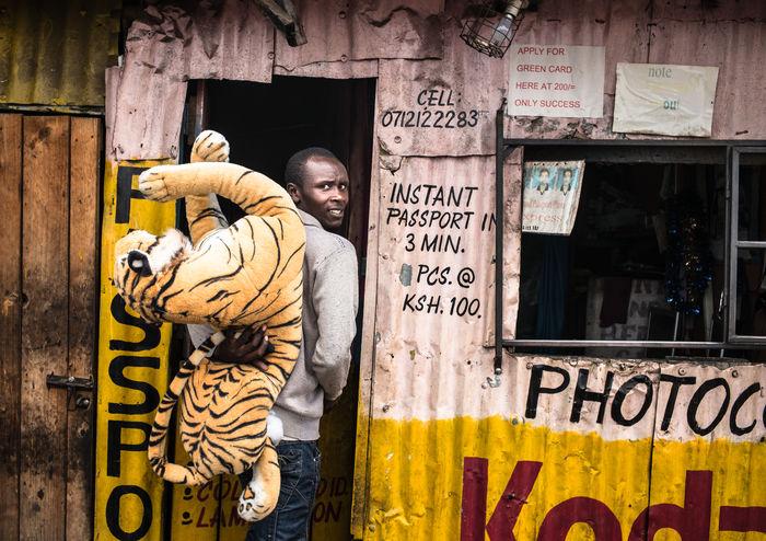 Analogue Photography Documentary Photography EyeEm Africa Kenya Kodak Nairobi Nairobi Kenya Thw Week On EyeEm Africa Africa Day To Day African Merchants Fotoladen Kenyan Stories Leica Passportphoto Photoshop Shot Digital Slum Area Streetphotography Tiger