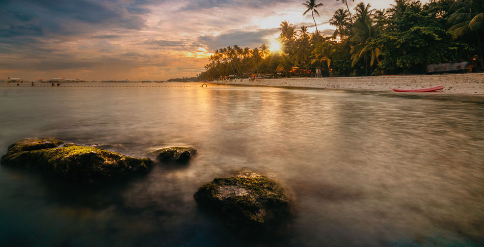 Bohol Philippines Beach Beauty In Nature Cloud - Sky Day Long Exposure Moored Nature Nautical Vessel No People Outdoors Palm Tree Reflection Scenics Sea Sky Sunset Tranquil Scene Tranquility Travel Destinations Tree Water Perspectives On Nature