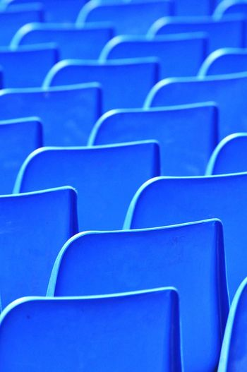 Full frame shot of empty blue chairs