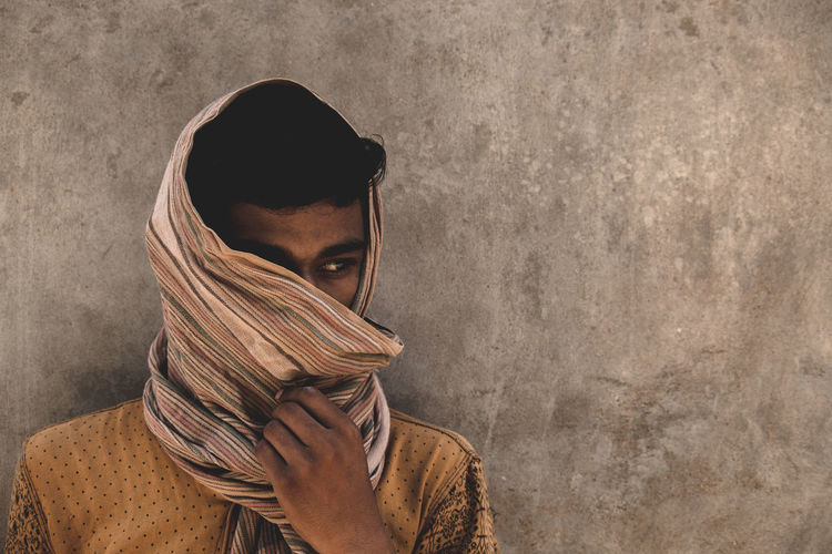 Adult Body Part Clothing Contemplation Front View Headshot Hood - Clothing Human Face Indoors  Leisure Activity Lifestyles Looking At Camera Obscured Face One Person Portrait Real People Scarf Standing Wall - Building Feature Warm Clothing Young Adult Young Men Young Women The Fashion Photographer - 2018 EyeEm Awards The Photojournalist - 2018 EyeEm Awards The Portraitist - 2018 EyeEm Awards