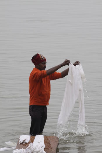 The washing man, Dhobi Wallah, washes the clothes in the river Ganges, the holy river. Benares Cleaning Dhobi Wallah Ganges River India Indian Indian Culture  Laundry Laundry Day Mother Ganga Travel Travel Photography Traveling Travelling Washing Cultures Day Ganges Ganges Ghat Indiapictures Outdoors Travel Destinations Travelling Photography Travelphotography Varanasi
