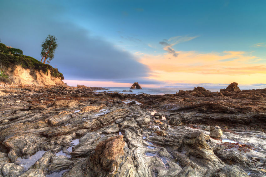 Little Corona Beach in Corona Del Mar, California at sunset in summer Beauty In Nature California Corona Del Mar Day Landscape Little Corona Beach Nature Ocean Outdoors Rocks Sky Sky And Clouds Sunset