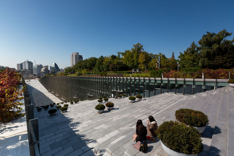 Campus of EWHA - Woman's University of Seoul, south Korea. Architket: Dominique Perrault Architecture Perrault Seoul Seoul, Korea Architecture City Clear Sky Day Ewha Ewha Womans University High Angle View Modern No People Outdoors Sky Skyscraper Tree Water
