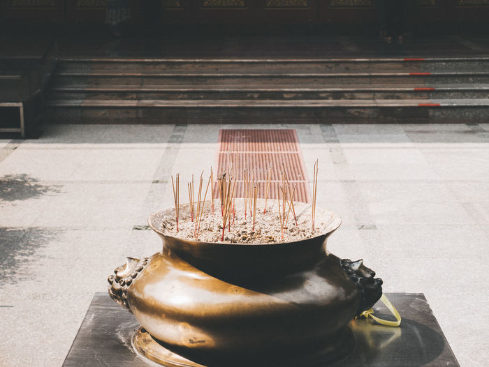 Incense sticks in the temple Architecture Belief Close-up Container Day Drink Food And Drink High Angle View Household Equipment Indoors  Metal Nature No People Place Of Worship Religion Spirituality Steel Still Life Sunlight Table