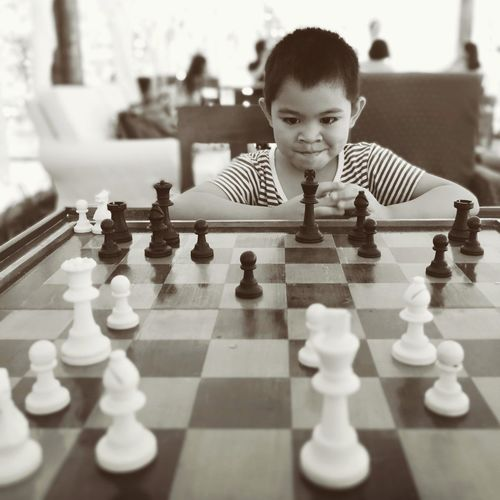 Smiling boy playing chess