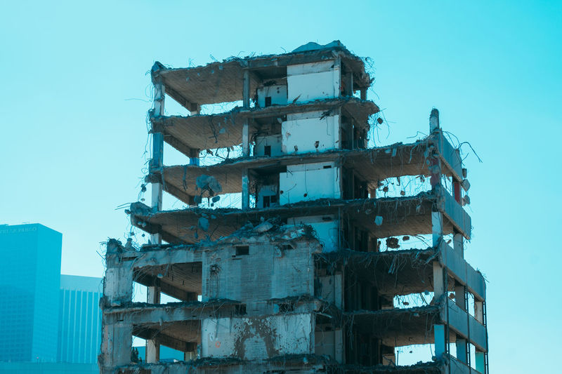 Low angle view of partly demolished building against sky