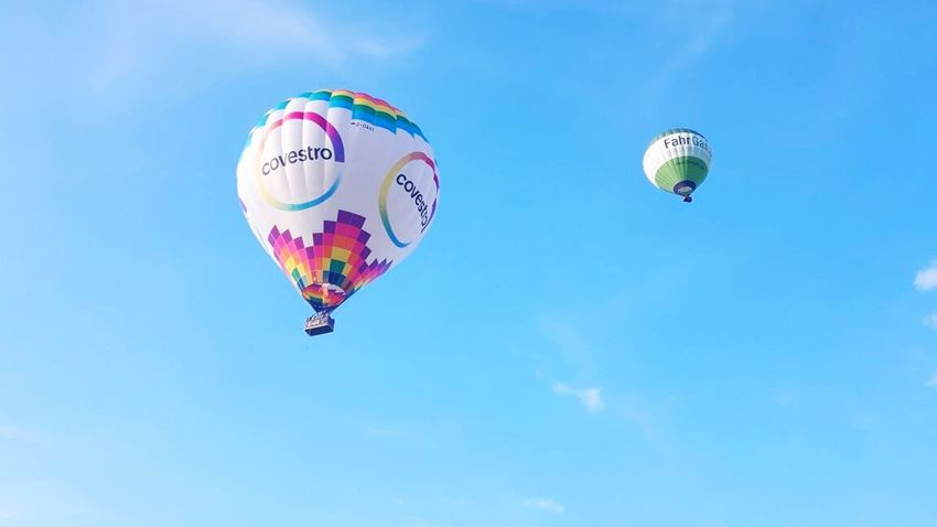 Mid-air Hot Air Balloon Blue Flying Sky Cloud - Sky Day Low Angle View Outdoors Multi Colored Ballooning Festival Vacations Parachute No People Vacations Hot Air Balloons Heißluftballon Nature Scenics Sky And Clouds Sister ❤ Love ♥ Aussicht View Landscape
