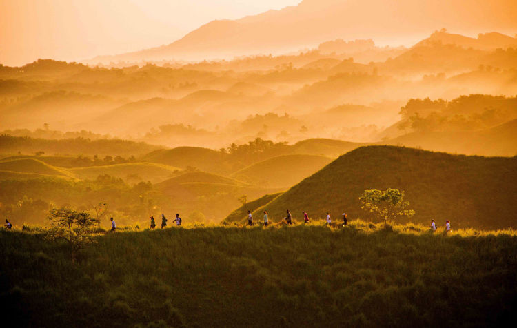 Morning trail on the hills while the sun is up. Mountain Scenics - Nature Land Environment Landscape Group Of People Beauty In Nature Field Tranquil Scene Plant Nature Mountain Range Tranquility Sky Outdoors Grass Sunset Non-urban Scene Idyllic Crowd