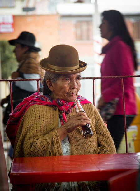 The Portraitist - 2017 EyeEm Awards This elder cholita caught my eye as soon as she sat down in her typical outfit, sipping on a coke and enjoying El Alto walk by. City Traditional Traditional Clothing Bolivia Cholita El Alto La Paz Coke Portrait Of A Woman Portrait Travel Travel Photography Portraiture