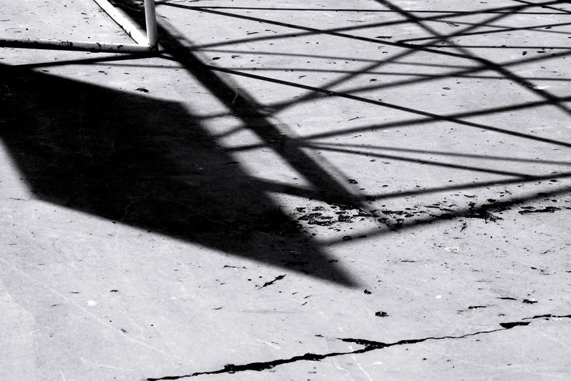 Shadow Sunlight High Angle View Focus On Shadow Day No People Outdoors Close-up Architecture Basketball Basket Court Basketball Court Sport Blackandwhite Black & White Welcome To Black Welcome To Black The Architect - 2017 EyeEm Awards